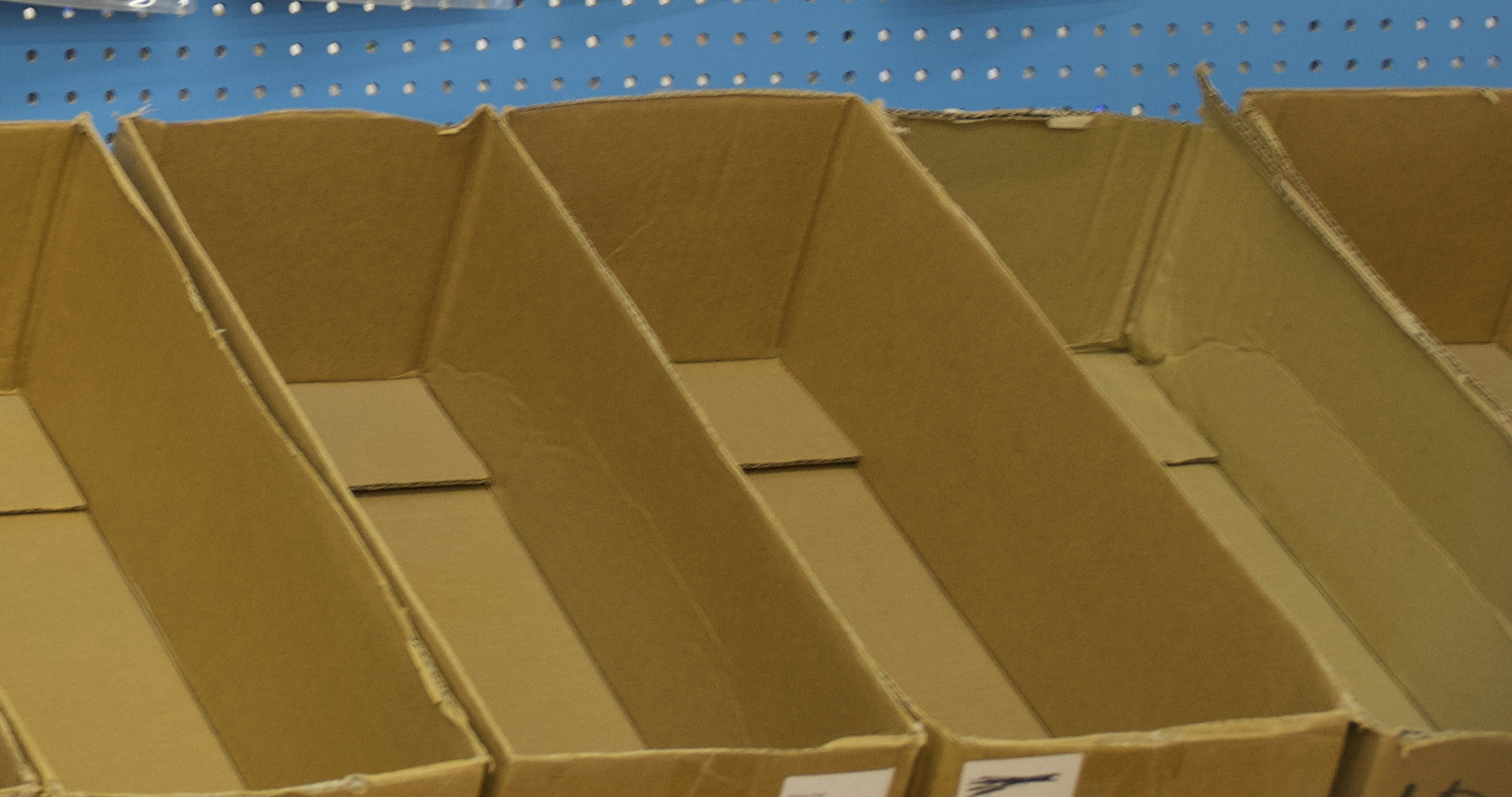 A series of open, empty cardboard boxes in a row