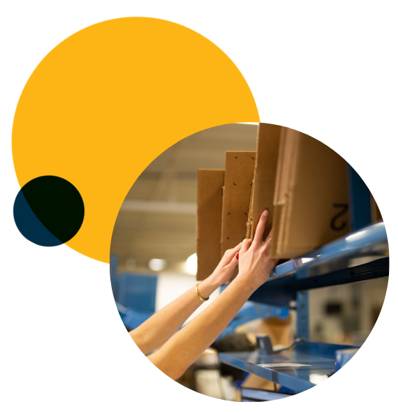 Efulfillment Service Close Up of Reaching For Boxes With Dots