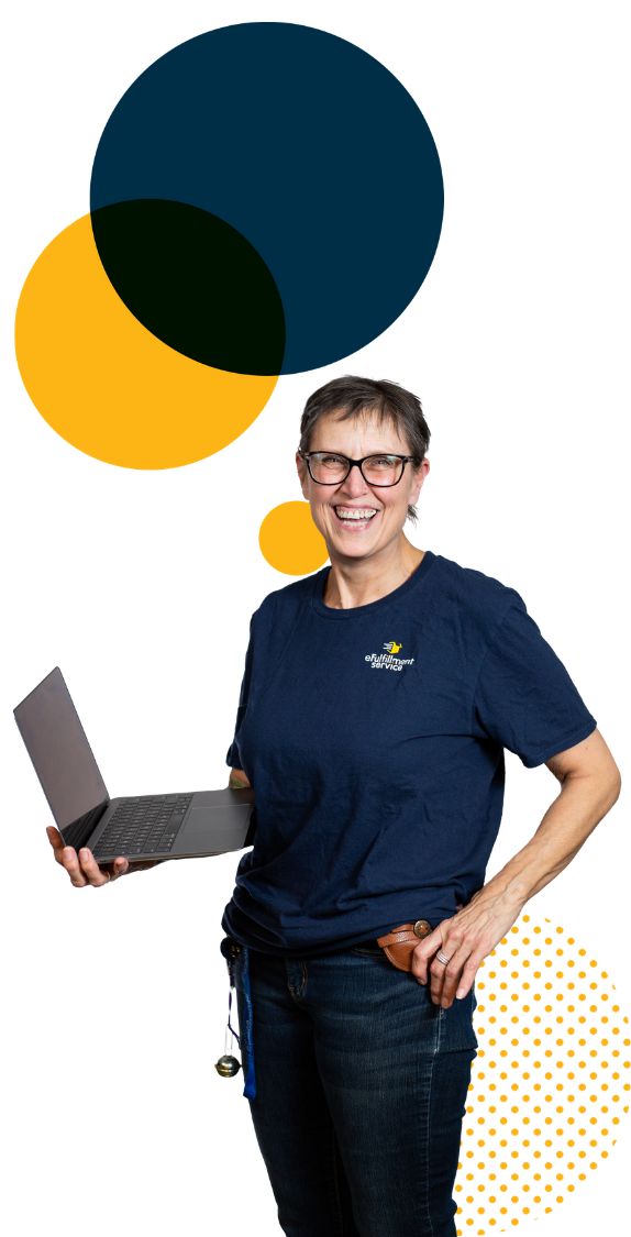 eFulfillment Service employee smiling with laptop and large dots