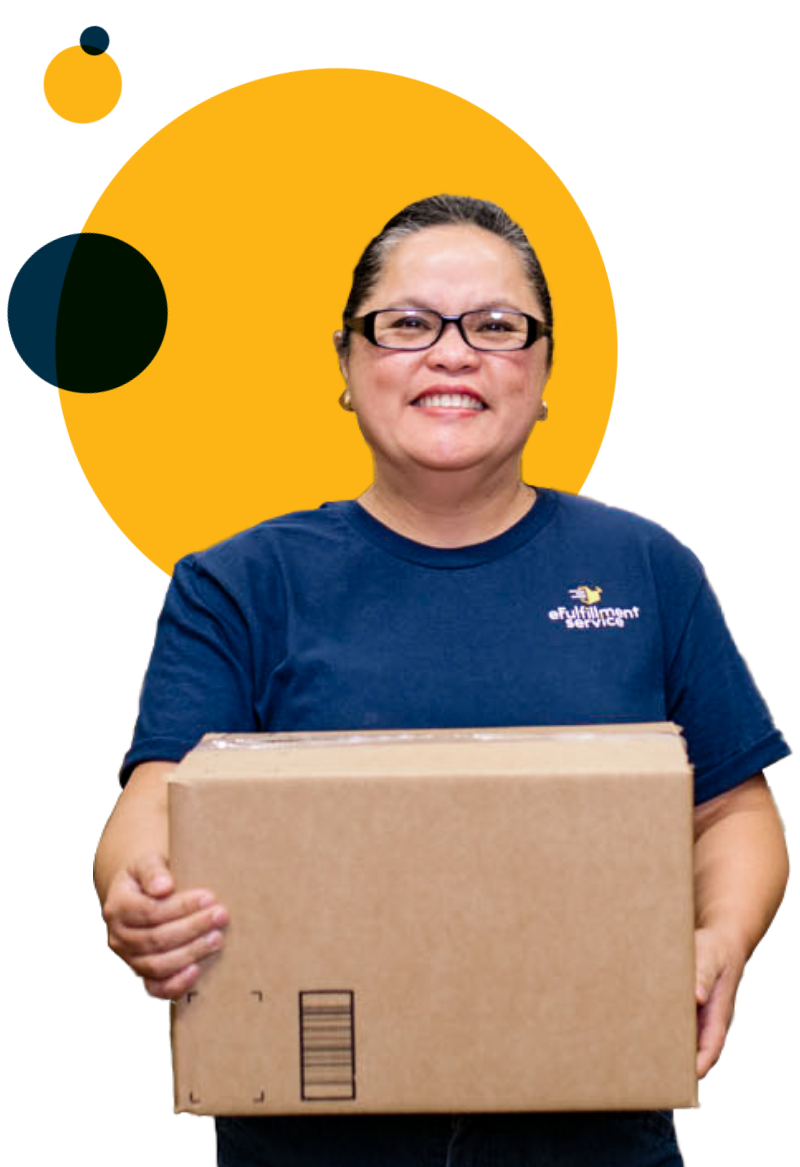 eFulfillment Service Employee Smiling with Box Wearing Glasses
