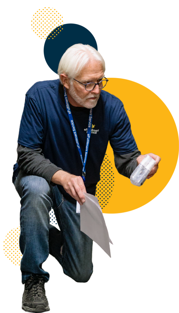 eFulfillment Service Older Man Kneeling With Papers and Product Dots